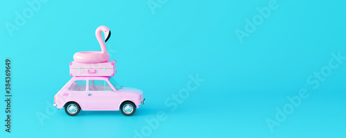 Fotografia Pink car with luggage and flamingo on pastel blue background