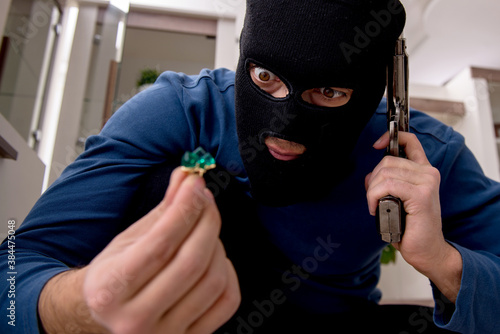 Stampa su Tela Male robber stealing valuable things from the house