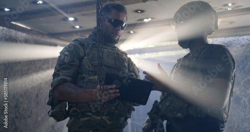 Photo Soldier showing region plan to commander