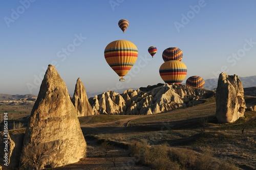 Canvas Print Hot air balloon flight over the Goreme valley, Cappadocia, Turkey, Asia
