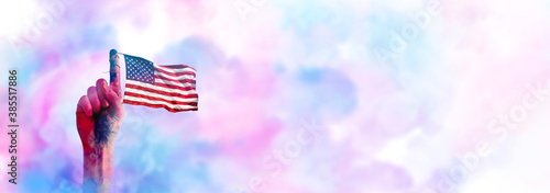 Fotografia, Obraz American flag tied on hand with colorful smoke background