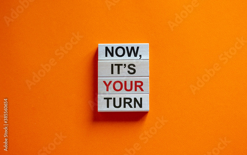 Murais de parede Wooden blocks form the words 'now, its your turn' on beautiful orange background