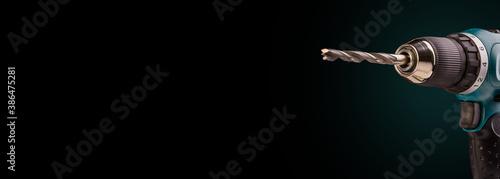Obraz na płótnie Electric screwdriver on black background