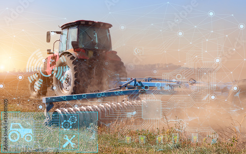 the concept of automation and the use of artificial intelligence in agriculture when processing the soil with a tractor before sowing a crop