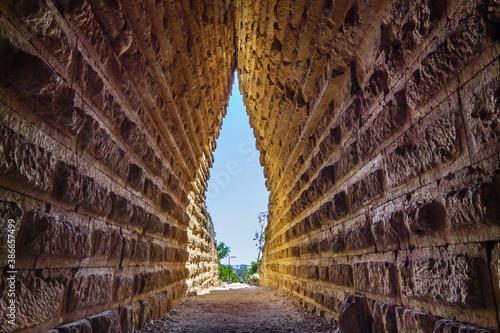 Fototapeta Tunnel inside Royal Kurgan, antique burial chamber of Bosporan king, Kerch, Crimea