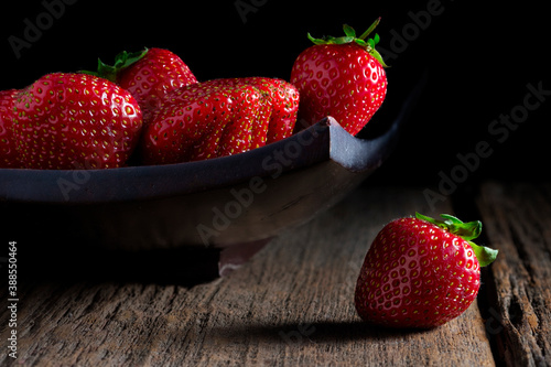 Canvas Print Large ripe strawberry berry on a wooden background