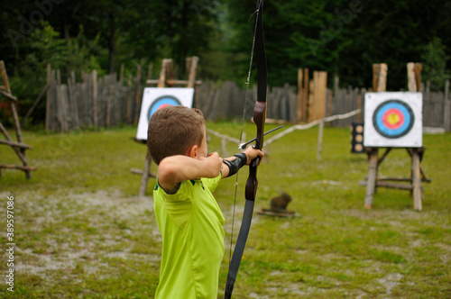 Leinwand Poster Boy at archery with bow and arrow