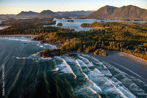 Fototapeta premium Landscape of Tofino covered in greenery surrounded by the sea in the Vancouver Islands, Canada