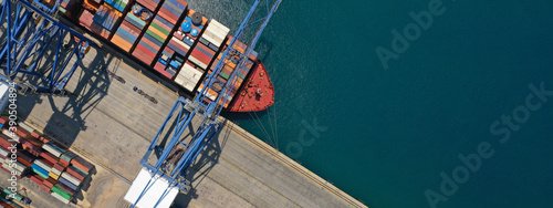 Fotografie, Tablou Aerial top down ultra wide photo of industrial cargo container ship loading in l