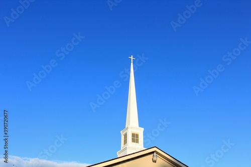 Wallpaper Mural church steeple with blue  sky in Sterling Kansas USA.