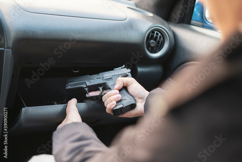 crime concept, burglar taking the pistol and plannung a murder Fototapet