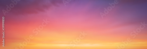 Fototapeta panorama of cloudscape at sunset with vivid and dreamy colors on sky