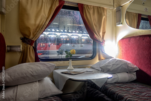 Photo classic interior of sleeping car of train