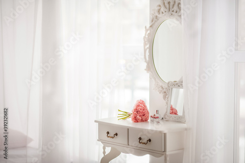 Tableau sur Toile Pink flowers on the dressing table in the white bedroom