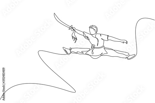One single line drawing of young man on kimono exercise wushu and kung fu jumping technique with sword on gym center vector illustration Fototapeta