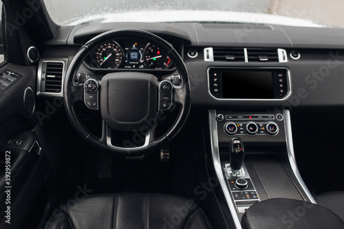 Expensive suv car interior with steering wheel, multimedia dashboard and gearbox фототапет