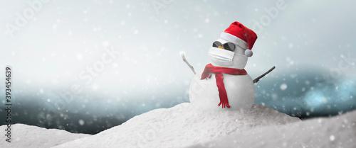 Photo Concept: snowman sunglasses, Santa hat and mask during coronavirus pandemic on s