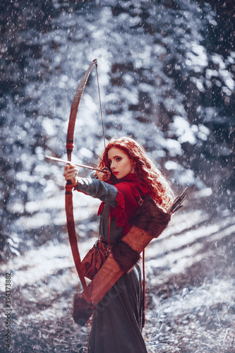 Canvas Print girl archer in a winter forest