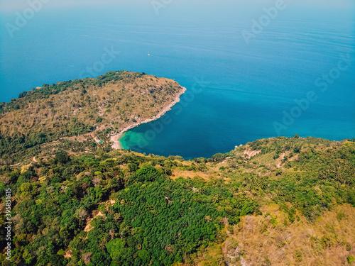 Stampa su Tela Bird's eye view of tropical isolated island with beautiful coast, blue aqua sea