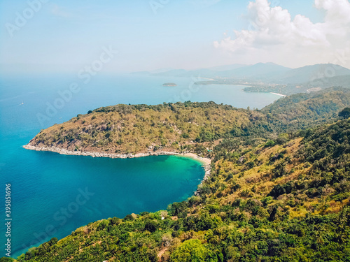 Carta da parati Top view or Aerial view of tropical island forest and emerald clear water of a m