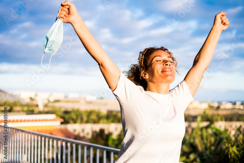 Photo one happy curly woman outdoors in her balcon of her home without medical mask wi
