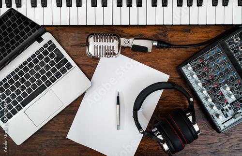 Fototapeta Music studio equipment and white paper with pen