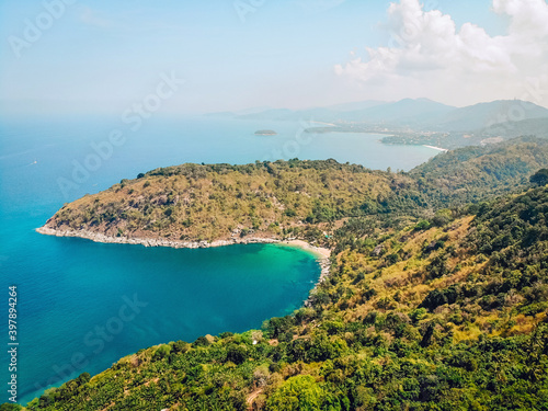 Stampa su Tela Top view or Aerial view of tropical island forest and emerald clear water of a m