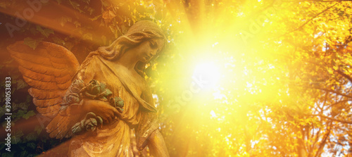 Fotografija Guardian angel statue in sunlight. Horizontal image.