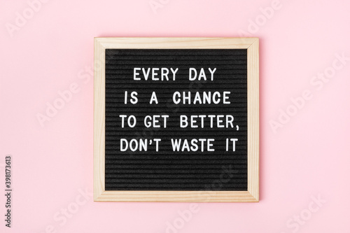 Every day is a chance to get better, don't waste it. Motivational quote on black letter board on pink background. Concept inspirational quote of the day. Greeting card, postcard