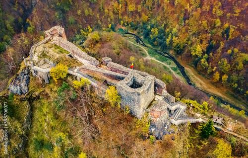 Fototapeta Famous Poenari citadel on background of romania mountains