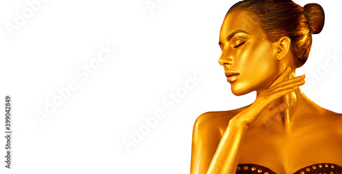 Golden skin, Woman portrait closeup. Model girl with holiday golden Glamour shiny professional make up. Isolated on white. Gold jewellery, jewelry, accessories. Beauty gold metallic body. Xmas art