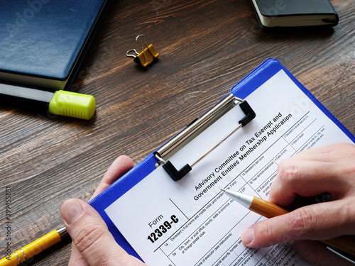 Photo Business concept meaning Form 12339-C Advisory Committee on Tax Exempt and Government Entities Membership Application with phrase on the sheet