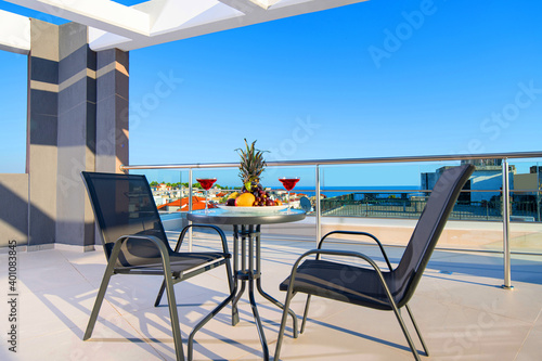 Canvastavla Recreation concept panorama of modern patio with fruits, wine, table, chairs on