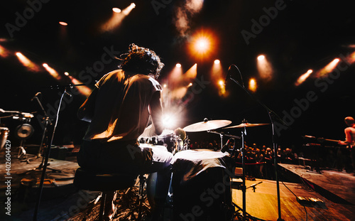 Canvas Print silhouette of drummer playing drums on a concert