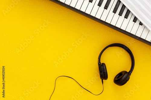 Fototapeta songwriter or dj work place with synthesizer and headphones