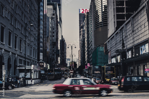 Photo Blurred Motion Of Car On Road Amidst Buildings In City