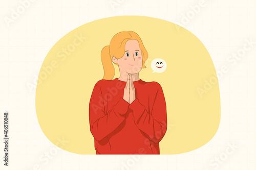 Obraz na plátně Pleading young woman holding hands folded in prayer concept