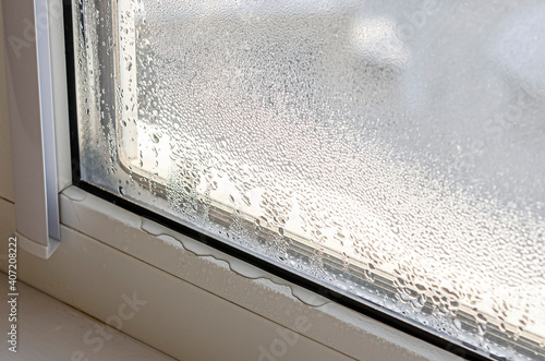 Drops of condensate and black mold on a substandard metal-plastic window