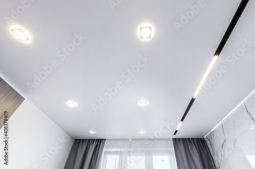 Canvas Print suspended ceiling with halogen spots lamps and drywall construction in empty room in apartment or house