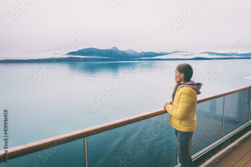 Alaska cruise travel tourist looking at mountains landscape from balcony deck of ship Fototapeta