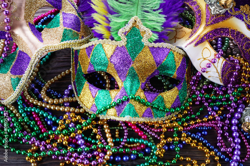 Wallpaper Mural A group of Venetian and New Orlean Mardi gras mask with colorful beads on dark b