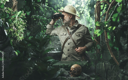 Fotografie, Tablou Explorer with binoculars in the jungle