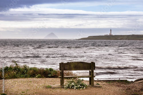 Fotografering seat with view of Ailsa Craig and lighthouse on Arran