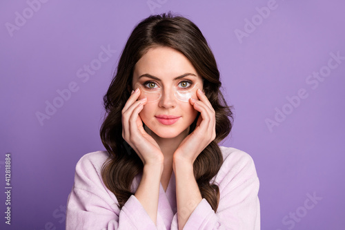 Photo of young girl enjoy cosmetology procedure apple eye patches lifting hydrat Fototapeta