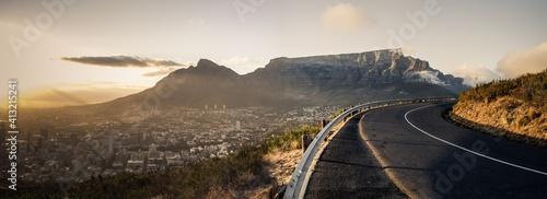 Fototapeta premium Road Amidst Cityscape Against Sky
