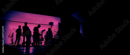 Canvas Print Behind the scenes of shooting video production and lighting set for filming movie which film crew team working in silhouette and professional equipment in studio for video online