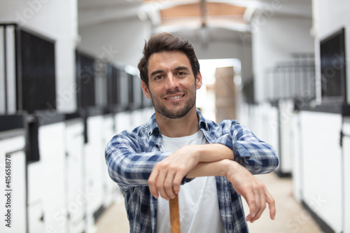 good looking worker posing in stable Fototapet
