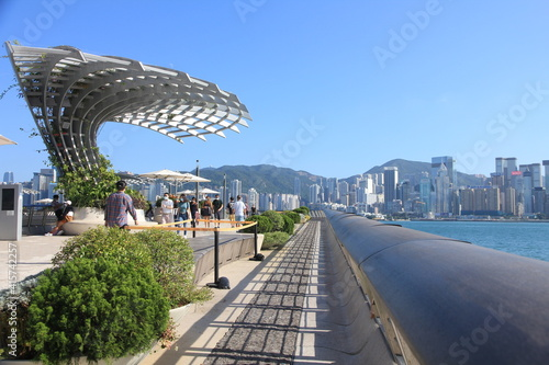Photo View of Victoria Harbour from the Avenue of Stars on a Sunny Day in Hong Kong
