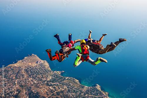 Fototapeta Skydiving group over the sea