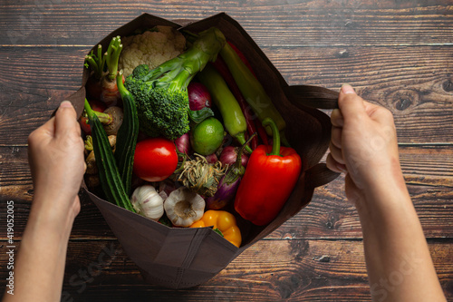 Valokuva healthy vegetables on wooden table,World food day